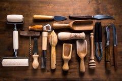 Vintage and retro kitchen untesil on wooden background Royalty Free Stock Photos
