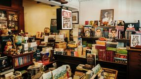 Vintage retro local bookshop with wooden bookshelf and a lot of. MAR 1, 2018 Uthaithani, Thailand : The Booktopia - Vintage retro local bookshop with wooden royalty free stock image