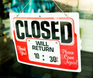 Vintage retro looking Closed sign in a shop showroom. With reflections Stock Photos