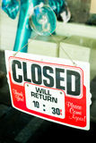 Vintage retro looking Closed sign in a shop showroom. With reflections Royalty Free Stock Photo