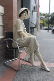 Vintage - Retro mannequin dressed. Vintage mannequin sitting in a chair outside a vintage clothes store in Napier, New Zealand. The mannequin is dressed in 1930 Stock Image