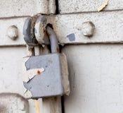 Vintage retro metal lock on a gray door. Classic hanging lock. Stock Images