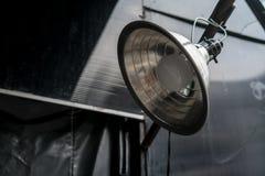 Vintage metal spot light hanging on metal bar. Vintage retro metal spot light hanging on metal bar Stock Images