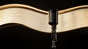 Vintage retro microphone on the black background Royalty Free Stock Image