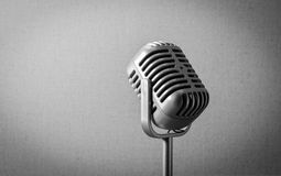 Vintage retro microphone. Vintage silver retro microphone on grey background Royalty Free Stock Photos