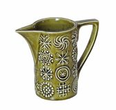 Vintage retro milk cream jug symbols signs pattern. Photo of a vintage Portmeirion ceramic milk cream jug in green colourway with striking geometrical shapes in royalty free stock photo