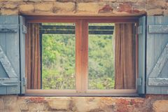 Vintage retro opened window with green natural background. Royalty Free Stock Photos