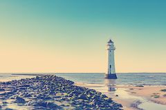 VINTAGE RETRO PHOTO FILTER EFFECT: New Brighton Perch Rock Light House, Merseyside, Birkenhead, The Wirrel, England, UK Royalty Free Stock Images