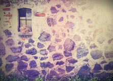 Vintage retro picture of stone wall with window Royalty Free Stock Image