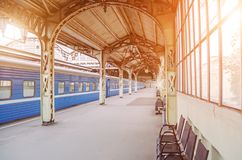 Vintage retro platform passenger railway station. Concept of meeting, waiting, seeing people on the road trip. royalty free stock photography