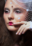 Vintage. Retro Portrait. Veiled Woman close up Stock Photos
