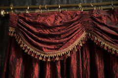 Vintage retro red curtain, fabric in theater. Indoor Royalty Free Stock Image