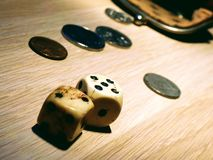 Dice with vintage wallet. Gambling. royalty free stock image