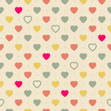 Vintage retro seamless pattern with colorful hearts on cloth background Royalty Free Stock Photo