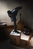 Vintage Retro Shoe, Cobbler Shop. Vintage retro woman shoe in an old cobbler shop waiting for repair. Nice fine art photography Stock Photo