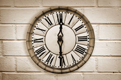 Vintage retro style clock on a white brick wall Royalty Free Stock Images