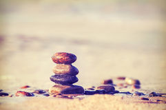Vintage retro style image of stones on beach Stock Images