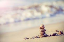 Vintage retro style image of stones on beach Royalty Free Stock Photo