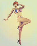 Vintage Retro Styled Pinup Illustration. Digital illustration of a classic pinup model in a vintage, retro style wearing American flag bikini Stock Images