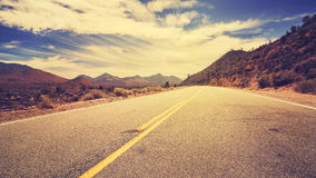 Vintage retro stylized desert road Royalty Free Stock Photography