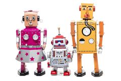 Tin toy robot family. Vintage retro  tin toy robot family concept isolated on a white background Stock Image
