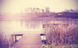 Vintage retro toned image of lake in autumn Royalty Free Stock Image