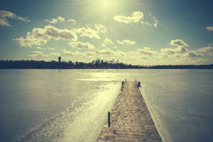 Vintage retro toned image of lake in winter Stock Photo