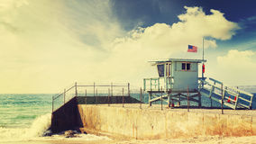 Vintage retro toned lifeguard tower. Stock Images