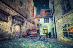 Vintage retro. Travel image of a narrow medieval street in old town Riga. night shining moon and stars Royalty Free Stock Photos