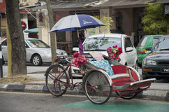 Vintage retro tricycle bike or rickshaw of Malaysian people ridi Royalty Free Stock Photography