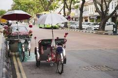 Vintage retro tricycle bike or rickshaw of Malaysian people ridi Royalty Free Stock Photo