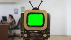 Vintage retro TV with a green screen at office background. stock video