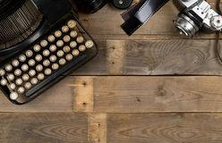 Vintage Retro Typewriter And Analog Film Camera On Wooden Table Background Top View Flat Lay From Above - Journalism Or Writer Royalty Free Stock Images