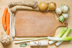Vintage retro vegetables and empty cooking board Royalty Free Stock Photo