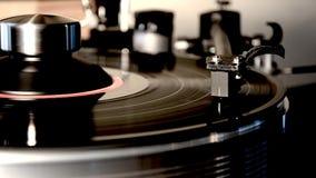 Vintage retro vinyl album black old record player disc gramophone on turntable in wonderful detailed close up loop shot. Fascinating detailed close up loop view stock footage