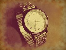 Vintage retro wrist watch in antique sepia color old version Royalty Free Stock Images