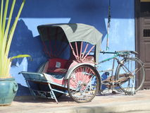 Vintage Rickshaw used many years ago by the Chinese to transport people around town. Royalty Free Stock Photo