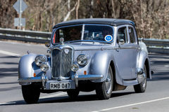 Vintage 1947 Riley driving on country road Stock Images