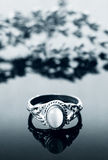 Vintage ring on reflective surface Royalty Free Stock Image