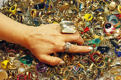 Vintage rings. A woman explores a huge pile of vintage rings Royalty Free Stock Image