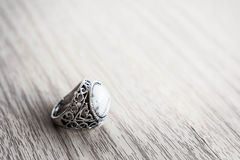 Vintage rings on a wooden table Royalty Free Stock Photo