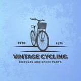 Vintage road bicycle emblem on blue grunge background. Bicycle repair and service. Classic bicycle logo. Vector Stock Photos