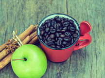 Vintage  roasted  coffee  beans with green apple  on wood backgroun Royalty Free Stock Photography