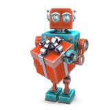 Vintage robot with gift box. Isolated. Contains clipping path Royalty Free Stock Photography