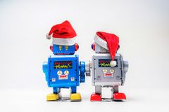 Vintage robot retro classic toy with Christmas hat on white back royalty free stock image