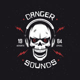 Vintage rock music related t-shirt graphics. Danger sounds. Authentic apparel. Vector illustration. Stock Photo