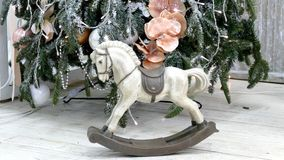 Vintage rocking horse. On christmas tree background