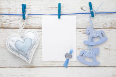Vintage rocking horse, fabric heart and empty card for adding text hanging on the rope on white wooden floor Stock Images
