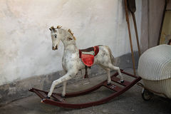 Vintage Rocking Horse. A vintage old rocking horse in a rustic setting Stock Photo