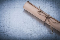 Vintage rolled corded parchment on scratched Royalty Free Stock Photo